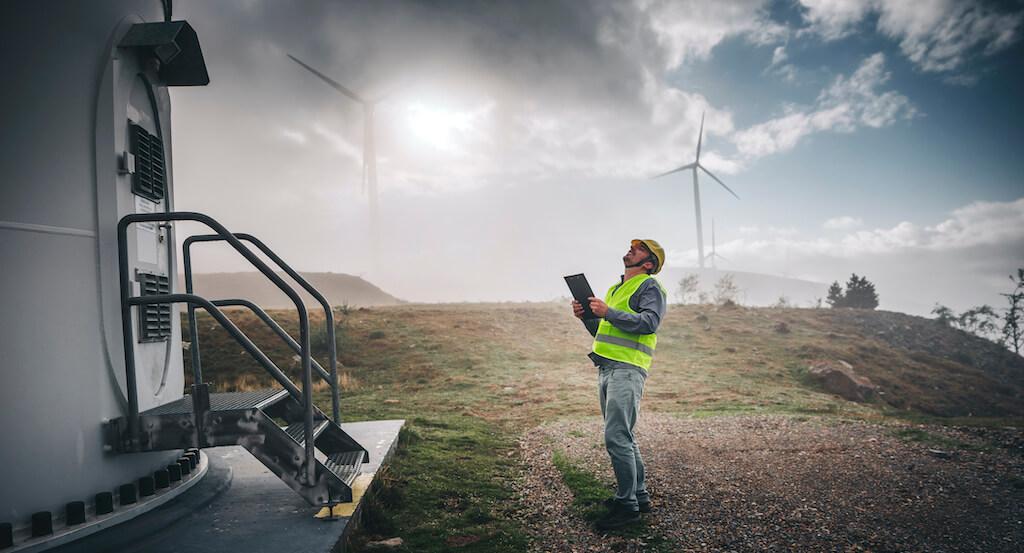 Man-looking-at-wind-turbine-data-storage